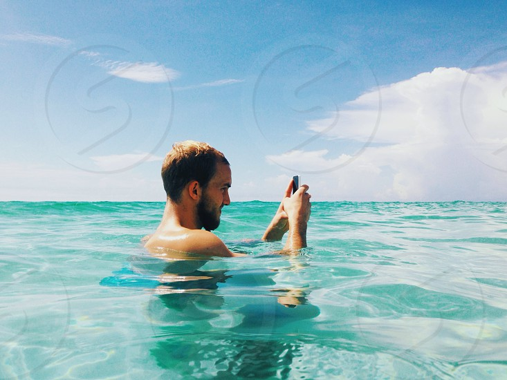 man taking photo using smartphone photo