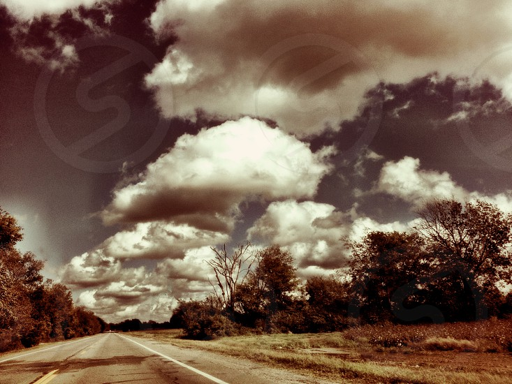 white clouds and road photography photo