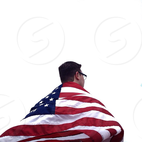 man covering his back with us flag photo