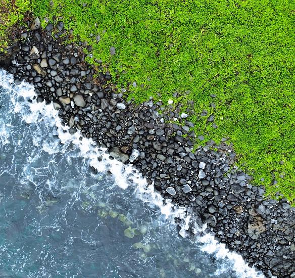 GreenseaoceanrockbeachcoastrockyaerialdroneMauiHawaiiabove photo