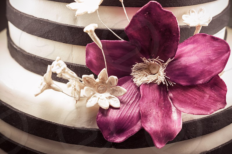 Details of a sugar flower with purple petals decoration of a cake.  photo