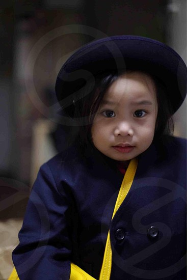 girl in blue coat and hat photo