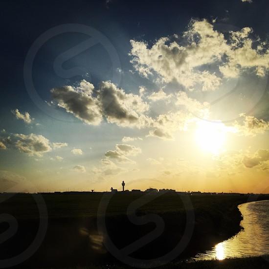 Schiphol airport sky cloud sun photo