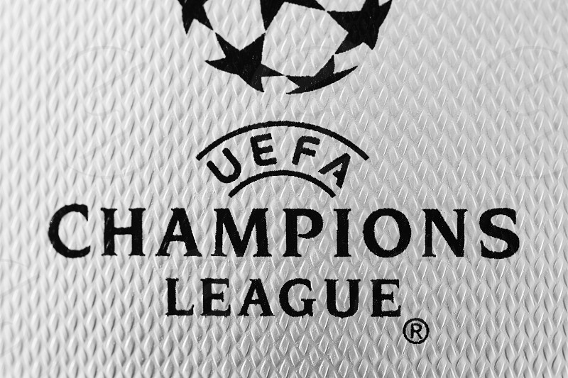 Kiev Ukraine - February 22 2018: Macro photo inscription on leather ball macro UEFA Champions League first Ukrainian final ball for the Champions League during UEFA Champions League game at NSC Olimpiyskyi stadium on May 26 2018 in Kiev Ukraine photo