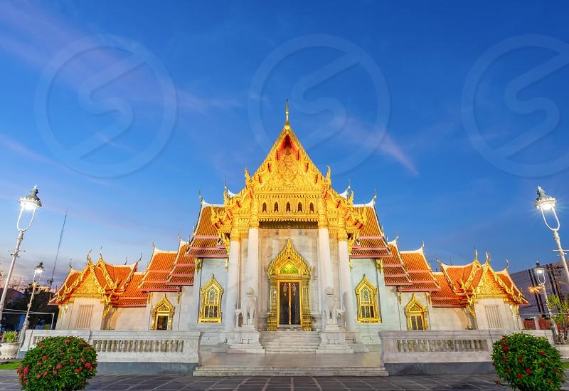 Thai Marble Temple (Wat Benchamabophit Dusitvanaram) night scene at dusk in Bangkok Thailand photo