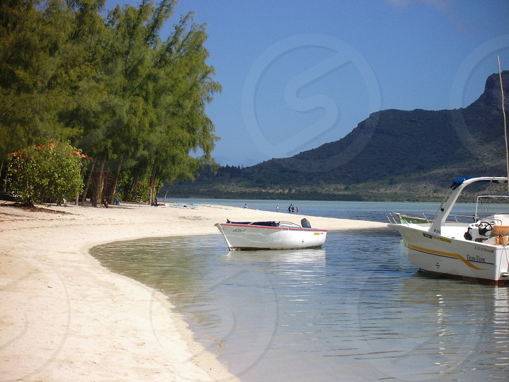 Mauritius beach with two boats photo
