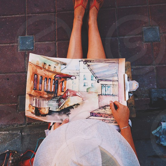 the girl paints a picture photo