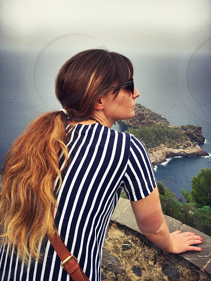 Young woman looking out to Mediterranean Sea in Mallorca  photo