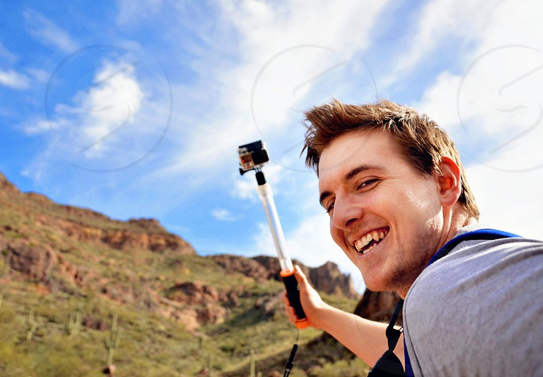 Men/man - guy lovingly holding video recording device photo