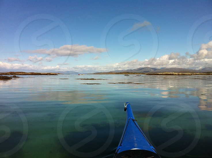 Sea Stillwater hills kayak boat water paddling Scotland clouds sky photo