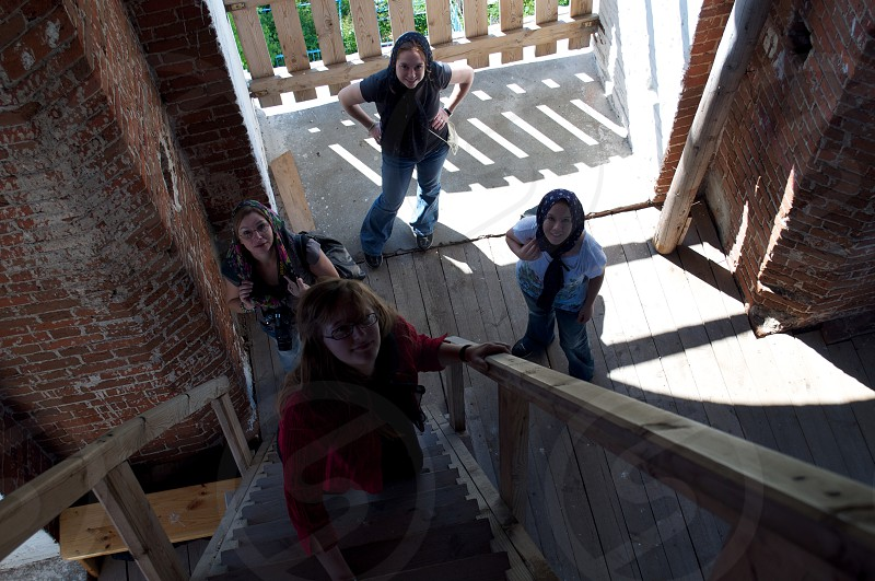 Point of view climbing a steep winding staircase to the top of a church tower.  photo