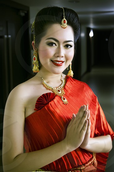 Pretty Asian lady in red dress Chinese new year party model modeling clothing fashion portrait reception 2 photo