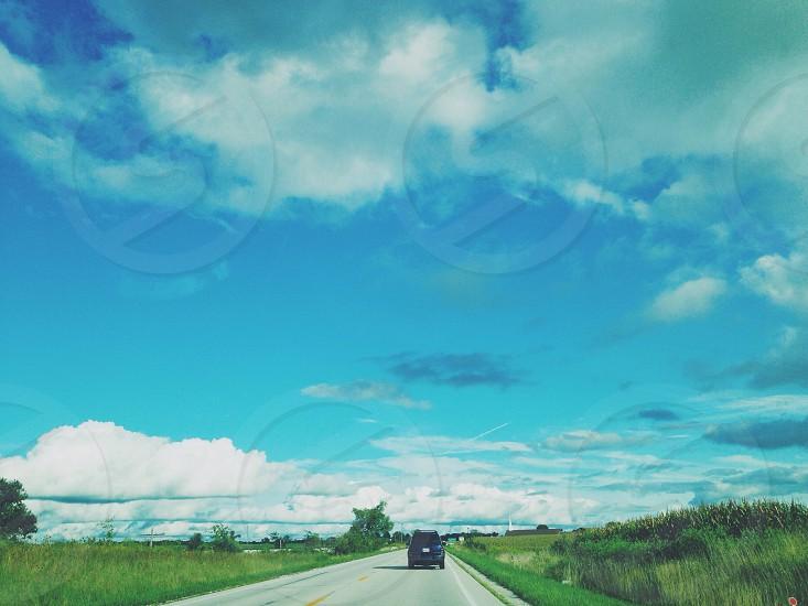 black suv on road photo