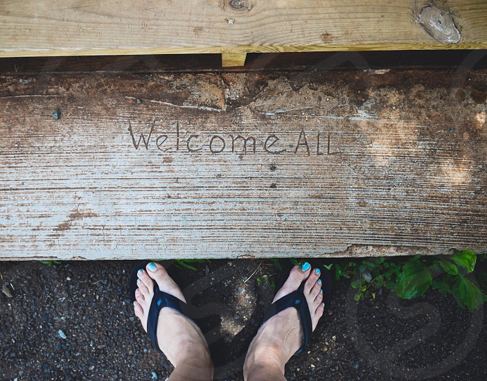 Feet welcome earthy kindness kind concrete dirt photo