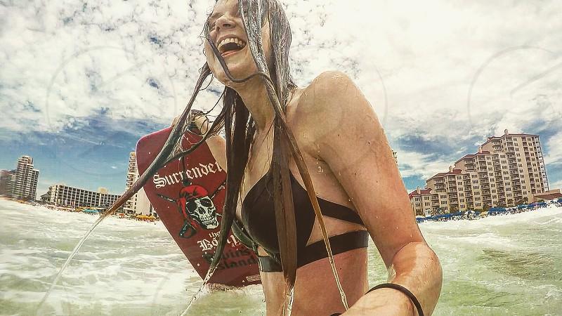 Girl friend beach love Florida water boogie board hair laugh photo
