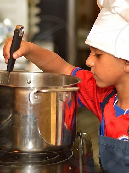 boy holding ladle photo