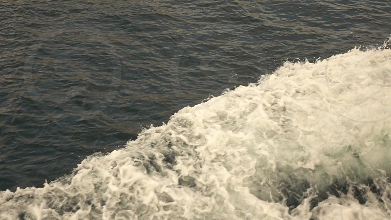 Top view slow motion large foamy waves from sea ship. Slow motion Full HD video 240fps 1080p. photo
