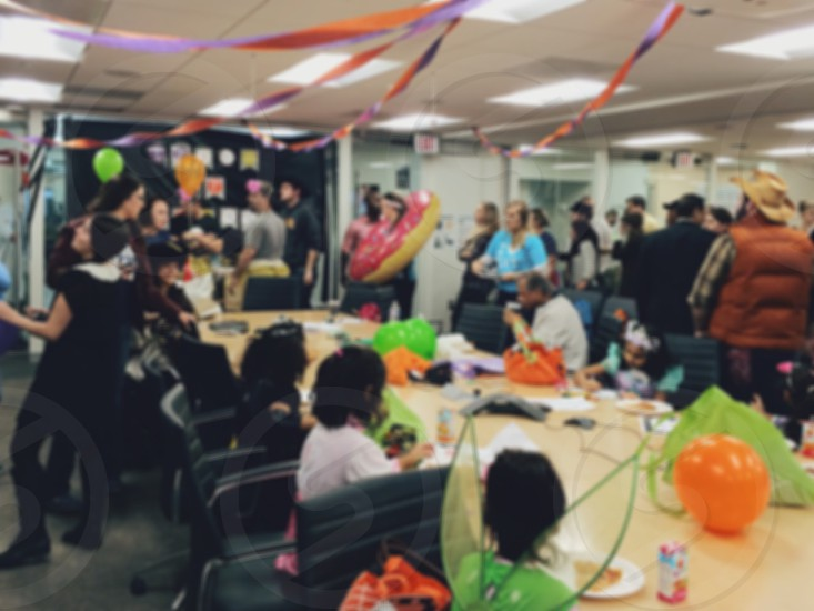 Halloween office party with kids and people. photo