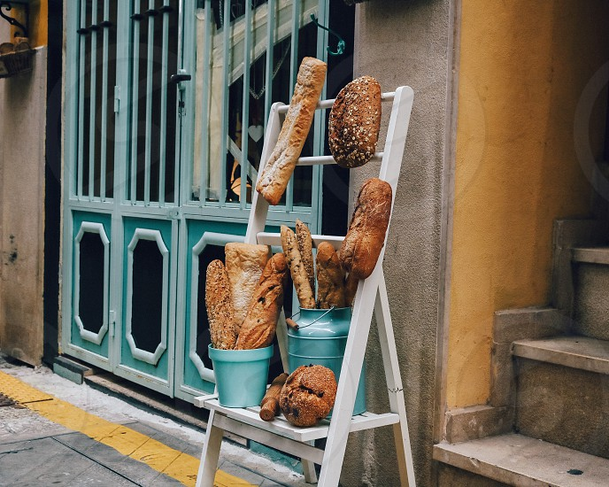 Bread and baguette presented outside by a bakery photo