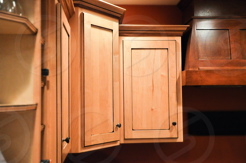 KITCHEN DETAILS | Thoughtfully picked out custom made cabinet oven hood built-in wine rack and wine shelves all handcrafted. photo