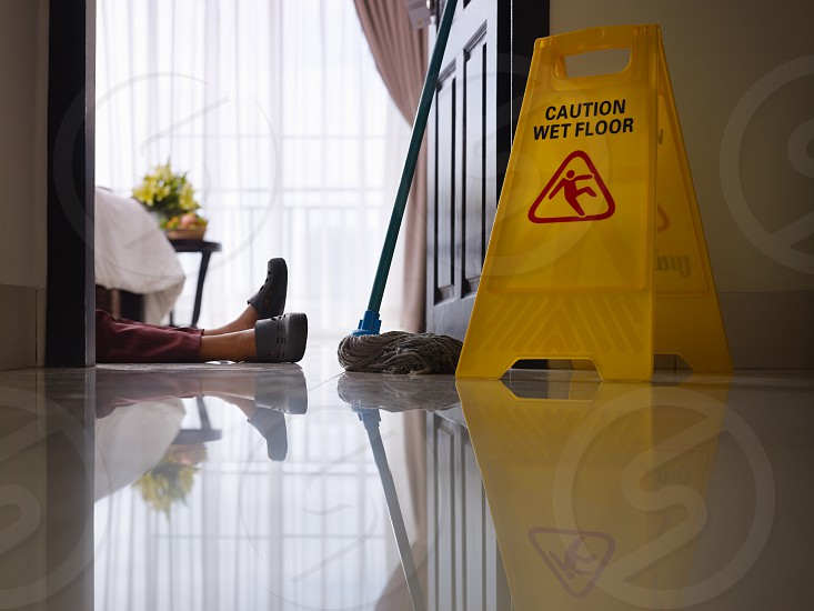 injury; fall; maid; hotel; room; housemaid; accident; adult; attention; bedroom; bizarre; caution; chores; clean; cleaner; cleaning; concepts; copy space; danger; employee; falling; feet; female; floor; hotel room; housekeeper; humour; indoors; insurance; job; laying; legs; manual; occupation; one; people; person; problems; reflections; service; side view; sign; slippery; warning; wet; woman; work; worker; working; young photo