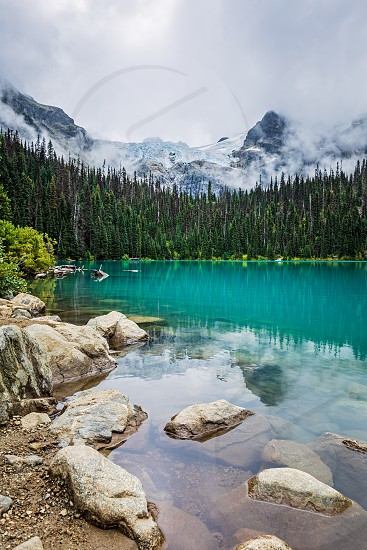 Mountain view of Matier Glacier over the serene turquoise colored middle Joffe lake in Beautiful British Columbia Canada photo