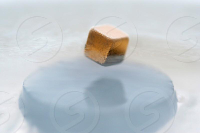 gold toned cube macro photography  photo