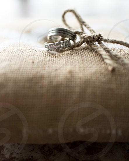 wedding wedding rings bride groom ceremony union vows silver diamond ring pillow photo