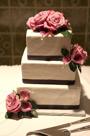 white black and pink 3 tiered cake photo