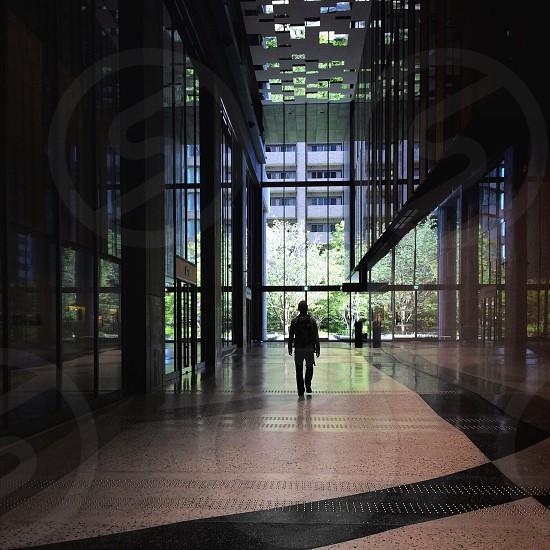 man walking on hallway photo