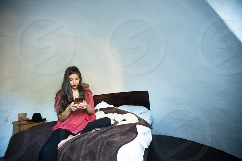 Young woman in her morning ritual in a minimalist room photo