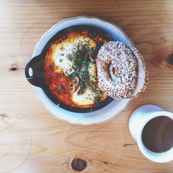 everything bagel in cheese soup near coffee mug photo