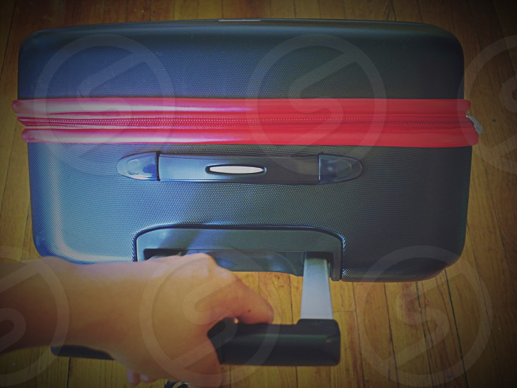 1st person perspective of pulling a suitcase. photo