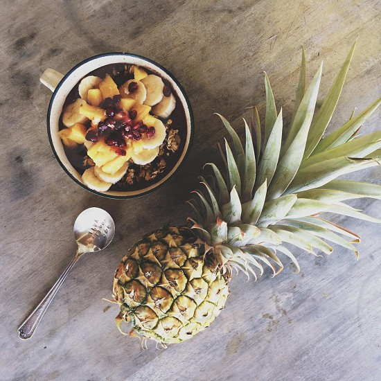 stainless steel spoon beside pineapple fruit photo