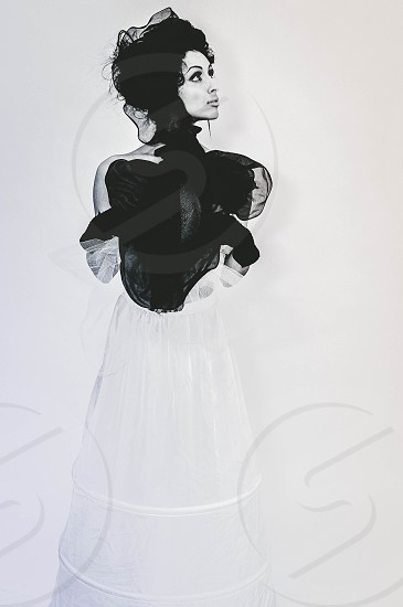 woman in black chiffon top and white skirt outfit photo
