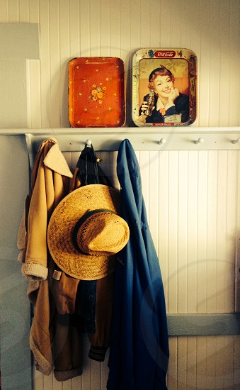 jackets and hat hanging on coat rack photo