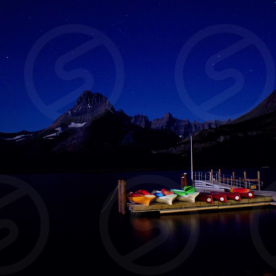 Canoes on river at night photo