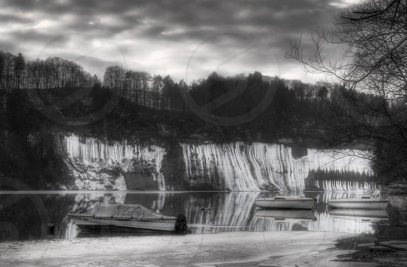 lake river cliff winter ice switzerland photo