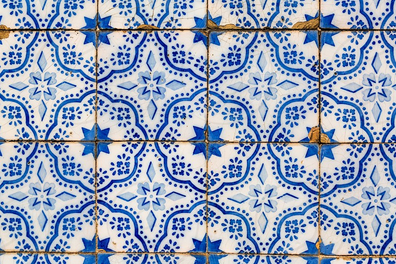 Typical decoration of the facade of the house in Lisbon. Traditional ceramic tiles Azulejos. photo
