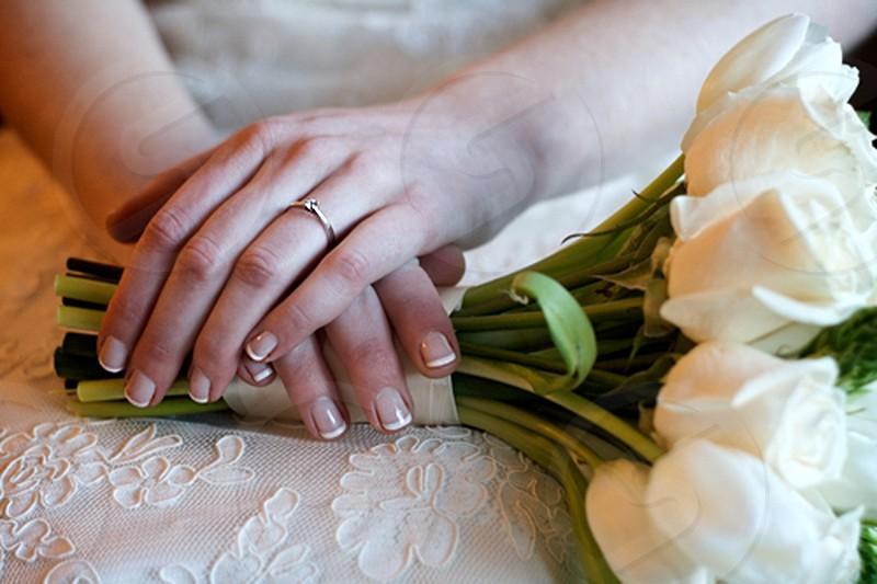 wedding ring hands roses bouquet diamond bride photo