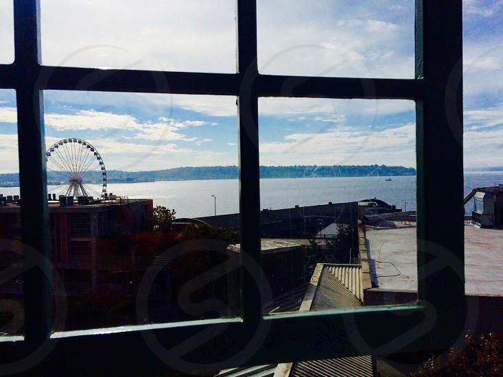 ferris wheel near body of water photo