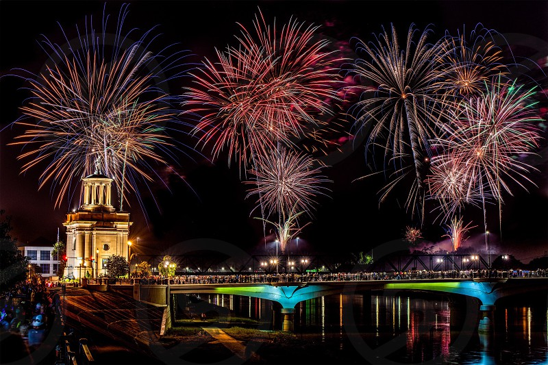 Hamilton Ohio 4th of July fireworks river bridge pyrotechnics night celebration people  photo