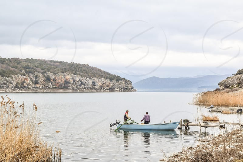 Two Fishermen With Their Boat Going For Fishing photo