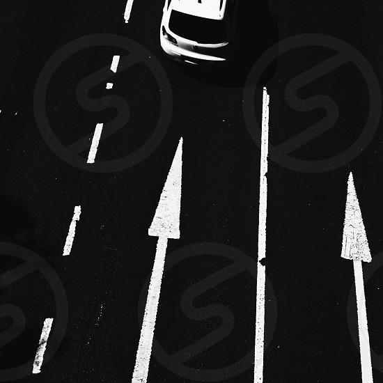 Car traffic highway road direction arrow b/w  photo