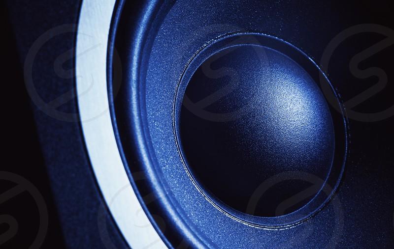 Modern speaker details closeup view on dust cap.  photo