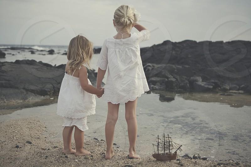 two girls wearing white blouse photo