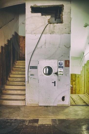 grey wooden door near stairs photo