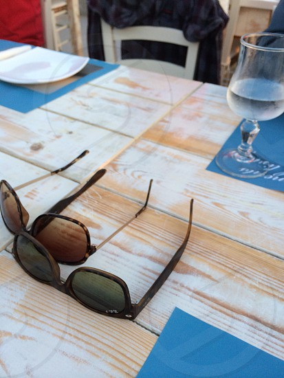 Sunglasses on a table photo