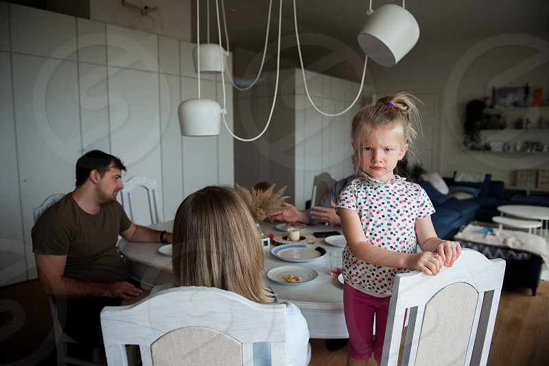 Family  sitting at table in living room photo
