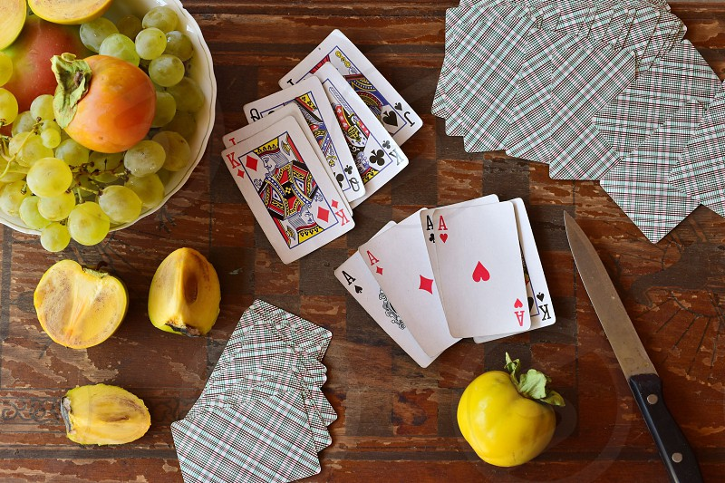Playing cards and fresh fruit on the table  photo